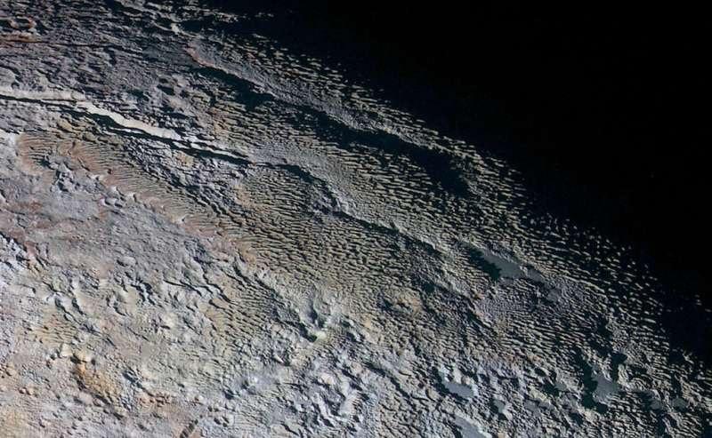 Pluto tartarus dorsa